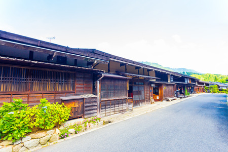 gifu: A row of connected wooden Japanese traditional houses on the main road in Tsumago, a post station town on the historic Nakasendo route in Japan