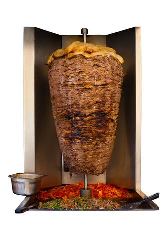 ラムロース串羊肉、shawarma にて、伝統的な肉または中東料理の地中海、アラブ諸国のケバブ サンドイッチで白い背景で隔離のマシンで唾を吐く