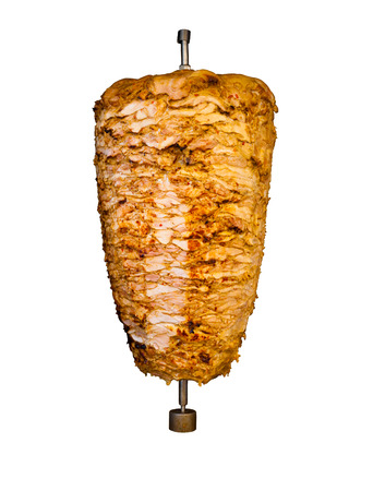 Grilled skewered chicken on spit, a traditional meat shaved, served inside kebab sandwich in Mediterranean and Arab countries in Middle East, cooked isolated on pure white background