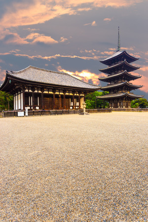 do: The front of the East Golden Hall, To-kondo, and five story pagoda, Goju-no-to, in Kofuku-ji Buddhist temple on beautiful sunset evening in Nara, Japan. Vertical copy space Editorial