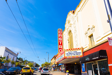 castro: San Francisco, USA - May 10, 2016: Castro Theater and nearby shops on a sunny, blue sky summer day in the heart of the traditionally gay district of the city. Horizontal