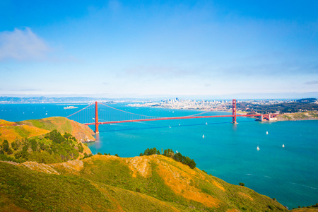 High angle, mid-air, aerial view of downtown San Francisco city, bay seen together with Golden Gate Bridge and hills of Marin headlands on a summer day in California. Telephoto compressed Stock Photo