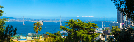 High angle detailed panoramic view of Bay Bridge linking East Bay with the Financial District over San Francisco Bay water on a sunny summer day in California