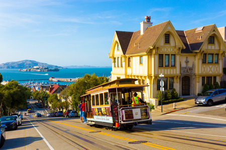 san: San Francisco, USA - May 12, 2016: Combined scenic view of San Francisco Bay with Alcatraz, cable car, Victorian houses, typical iconic siteseeing landmarks and tourist attractions of the city