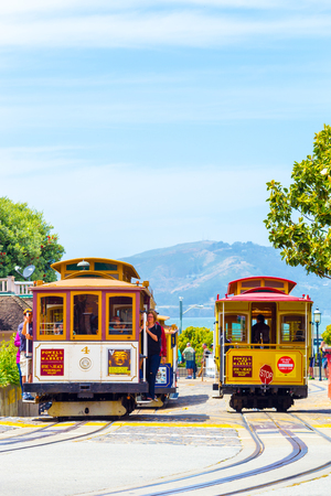 turnaround: San Francisco, USA - May 19, 2016: Tourists wait at terminal cable car turnaround station, the end of the line at Hyde Street, Fishermans Wharf with Marin Headlands in background. Vertical Editorial