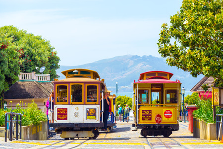 wharf: San Francisco, USA - May 19, 2016: Tourists wait at terminal cable car turnaround station, the end of the line at Hyde Street, Fishermans Wharf with Marin Headlands in background. Horizontal