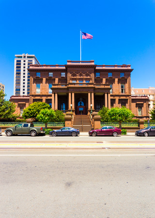 San Francisco, USA - May 20, 2016: Historic brownstone house, the former Flood Mansion is home to Pacific-Union Club on California Street on Nob Hill in sunny San Francisco. Vertical
