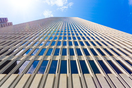straight up: Front facade of One Embarcadero building from low angle looking straight up into the sky in San Francisco, California on a sunny summer day. Stock Photo