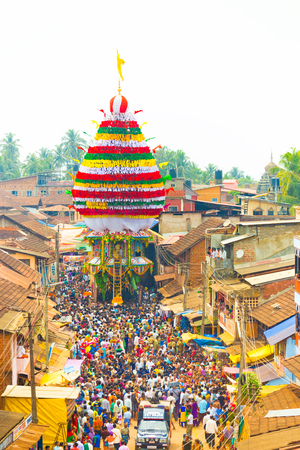 karnataka: Gokarna, India - March 3, 2016: Crowd of people gather to pull the oversized ratta chariot during annual Shivarathri festival. Vertical high aerial view
