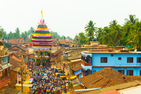 maha: Gokarna, India - March 3, 2016: Crowd of people gather to pull the oversized ratta chariot during annual Shivarathri festival. Horizontal high aerial view