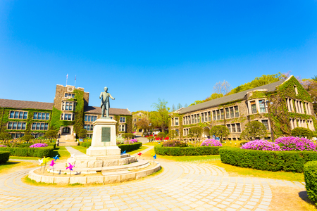 venerable: Ivy covered brick buildings surround the quad with Horace Grant Underwood statue at venerable Yonsei University in Sinchon, Seoul, South Korea. Horizontal Editorial