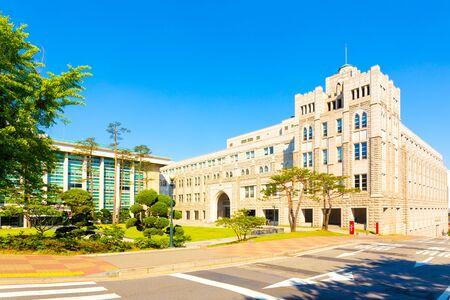 law school: Beige Law School building on the campus of Korea University on a sunny, blue sky day in Seoul, South Korea
