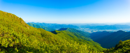 valley below: Panoramic view from Jirisan Mountain viewpont to valley below on a clear, spring day in South Korea. Horizontal Stock Photo