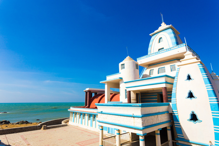 southernmost: Side oceanfront view of Gandhi Memorial Mandapam on the Indian southernmost tip city of Kanyakumari on a sunny, blue sky day in Tamil Nadu, India. Horizontal