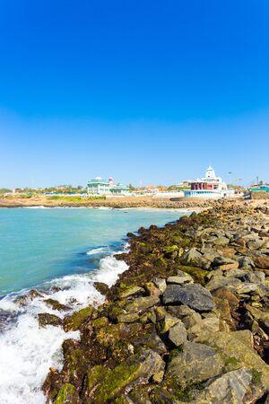 Landscape view of Kamarajar and Gandhi Memorial Mandapam on the coastline of Kanyakumari on a sunny day in Tamil Nadu, India. Vertical Stock Photo