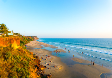 High angle view of sandy beach at low tide and ocean from cliffs on a clear, blue sky day in Varkala, Kerala, India. Horizontal Stock Photo