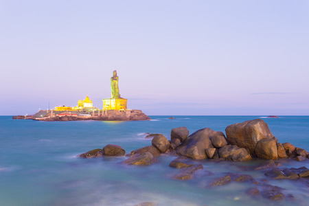 neighboring: Vivekananda Rock is home to a memorial and neighboring island Thiruvalluvar Statue lighted at dusk blue hour off the coast of Kanyakumari, Tamil Nadu, India