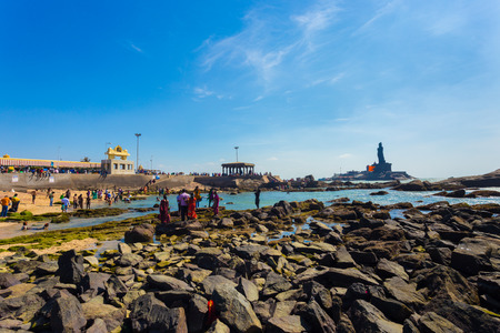 southernmost: Kanyakumari, India - February 22, 2015: Indian tourists swimming in shallow ocean water near Thiruvalluvar statue and 16 legged mandap pavilion in southernmost tip city in Tamil Nadu Editorial