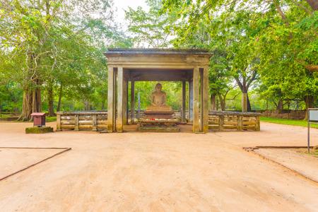 samadhi: Dirt footpath leading to sacred Samadhi Buddha Statue in ancient capitol of Anuradhapura in Sri Lanka. Horizontal