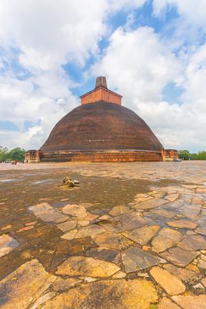 dagoba: Jetavanaramaya Dagoba or stupa ruins with broken spire seen centered from corner in the ancient capitol of Anuradhapura Kingdom on a beautiful blue sky day in Sri Lanka