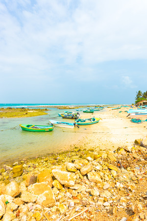 Point Pedro, Sri Lanka - February 4, 2015: A local fishing village with anchored fishermens boats on the beach is seen along the northern coast in Jaffna. Vertical