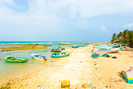 destination scenics: Jaffna, Sri Lanka - February 4, 2015: A local fishing village with anchored fishermens boats on the beach is seen along the northern coast in Point Pedro. Horizontal