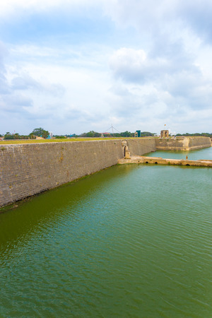 Distant view of entrance and bridge over moat into Jaffna Fort in Sri Lanka. Vertical