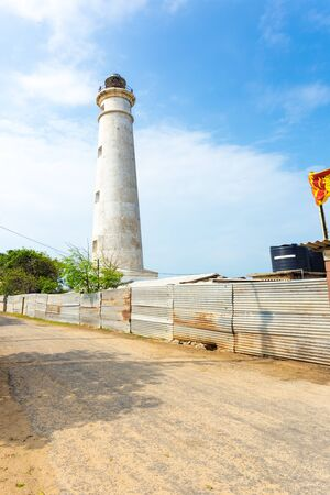 A rural road runs alongside the Point Pedro Lighthouse, now occupied by the military on the northern coast of Jaffna, Sri Lanka