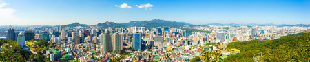Seoul, South Korea - September 18, 2014: Panoramic high angle aerial view of downtown city center Seoul and Bukhansan mountain background on a sunny blue sky day