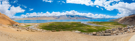 panoramic sky: Hilltop sweeping panoramic view of Tso Moriri Lake on clear blue sky summer day in Ladakh, India Stock Photo