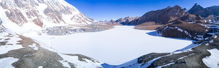 Tilicho Lake frozen covered with snow in the Himalayas of Nepal