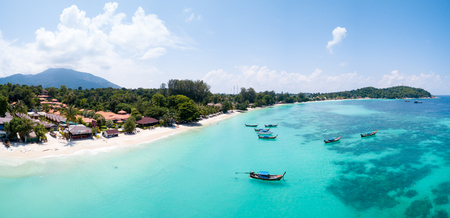 Aerial panoramic view of Pattaya Beach over crystal clear tropical water on island paradise Ko Lipe, Thailand