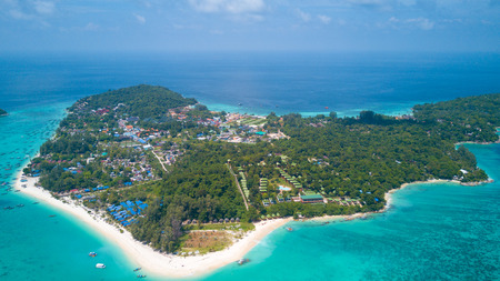 High aerial overview of entire tropical Thai island of Ko Lipe and Andman Sea in Thailand