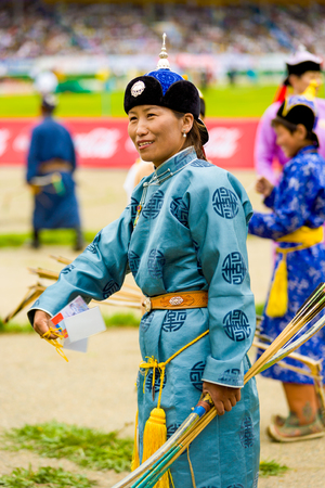 garb: Ulaanbaatar, Mongolia - June 11, 2007: Female archery competitor in traditional garb participating in opening ceremony of the Naadam Festival