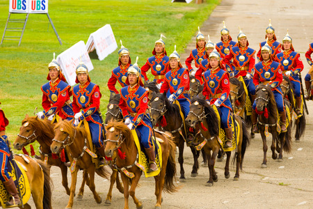 Ulaanbaatar, Mongolia - June 11, 2007: Soldiers in uniform on horseback participating in the opening ceremony of the Naadam Festival