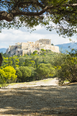 Framed view of the Parthenon at the Acropolis viewed from Filopappou Hill in Athens, Greece. Vertical