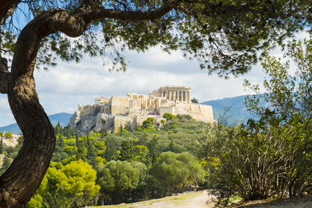 Framed view of the Parthenon at the Acropolis viewed from Filopappou Hill in Athens, Greece. Horizontal
