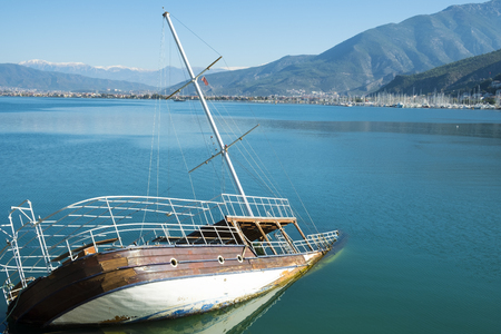 Sunken shipwreck boat in the sea off the coast of Fethiye, Turkey. Horizontal