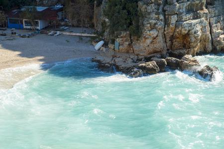 High angle view of turquoise Mediterranean Sea water at Mermaid Beach in Kas, Turkey. Horizontal