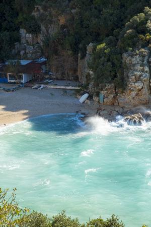 High angle view of turquoise Mediterranean Sea water at Mermaid Beach in Kas, Turkey. Vertical