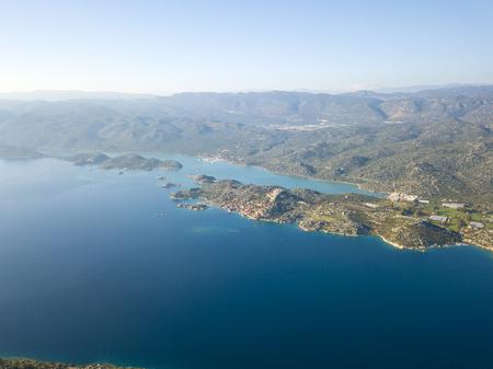 Aerial drone view of Kalekoy Castle with Ucagiz in the distance in Kekova, Turkey