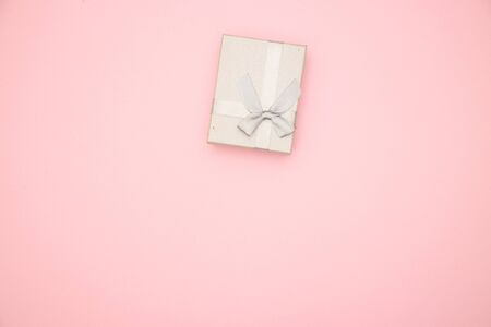 Silver present box on pink background