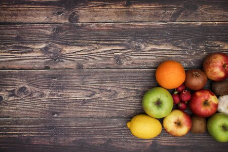 Group of fresh fruits on the wooden table Stock Photo