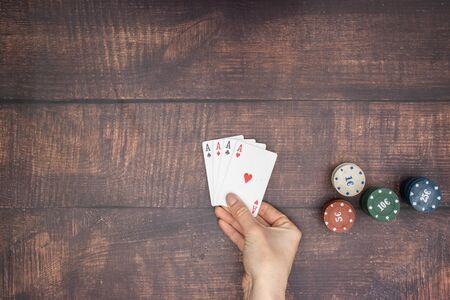 Woman's hand hold four aces Standard-Bild - 127974060