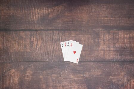 Four aces on the table in poker game Standard-Bild - 127974071