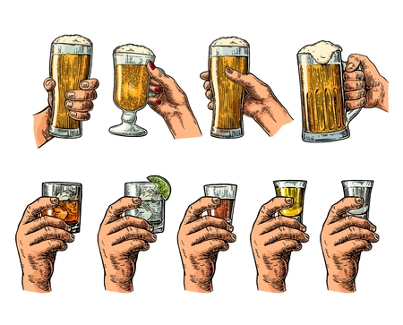 Male hand holding glasses with beer, tequila, vodka, rum, whiskey and ice cubes.