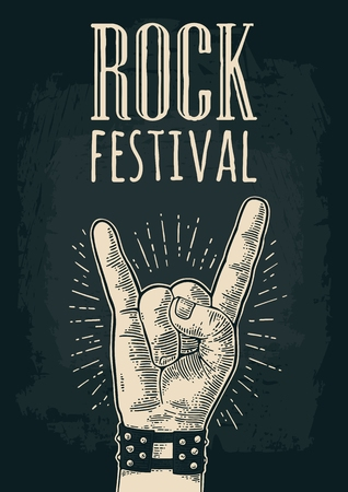 devil ray: Rock and Roll sign. Hand with metal spiked bracelet giving the devil horns gesture. Vector monochrome vintage engraved illustration. Isolated on dark background. For festival poster Illustration