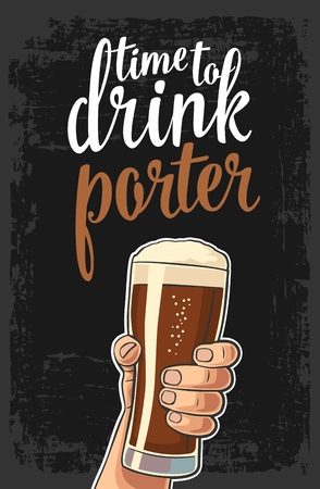 Male hand holding a beer glass with porter.