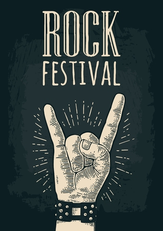 Rock and Roll sign. Hand with metal spiked bracelet giving the devil horns gesture. Vector monochrome vintage engraved illustration. Isolated on dark background. For festival poster Çizim