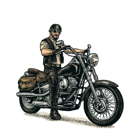 Man in a classic motorcycle with helmet and glasses.